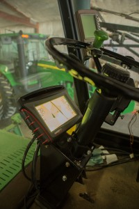 Large agricultural equipment is furnished with GPS systems, much like your car. The GPS aids in planting accurate rows of crops, as well as applying fertilizers. Photo credit: Ron Bolte