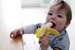 child-eating-a-banana